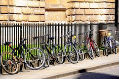 Bicycles leaning against railings, Oxford. Royalty Free Stock Photography