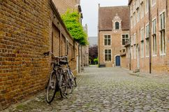 Bicycles leaning against the wall in Begijnhof Leuven Royalty Free Stock Photography