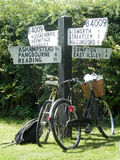 Bicycles leaning on four points signpost. In village of Aldworth, Berkshire, England Royalty Free Stock Image