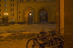 Bicycles left on parking for the whole winter Evening, snowfal. Royalty Free Stock Photo