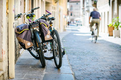 Bicycles in narrow street. Bicycles with bags in narrow street Royalty Free Stock Photo
