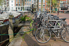 Bicycles next to canal of Amsterdam Stock Image