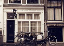 Bicycles outside shop, Amsterdam Stock Images