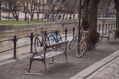 Bicycles on the park by the river bank. Spring park view along the Aura River Royalty Free Stock Photo