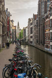 Bicycles parked against a canal in Amsterdam Royalty Free Stock Photography