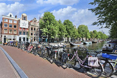 Bicycles parked againt railing in Amsterdam Stock Photos
