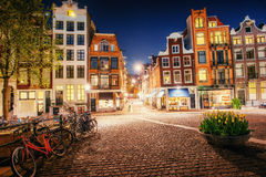 Bicycles Parked Along a Bridge Over the Canals of Amsterdam, Net Royalty Free Stock Image