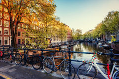 Bicycles Parked Along a Bridge Over the Canals of Amsterdam, Net Royalty Free Stock Photo