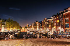 Bicycles Parked Along a Bridge Over the Canals of Amsterdam, Net Stock Image