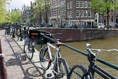 Bicycles parked on an Amsterdam bridge Royalty Free Stock Image