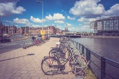 Bicycles parked in Amsterdam, Netherlands - retro and vintage st Royalty Free Stock Photos