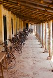 Bicycles parked around a corridor. Some bicycles parked around a corridor of a village school unique photo royalty free stock photography