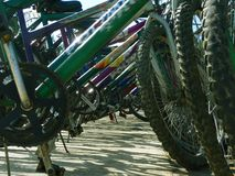 Bicycles parked in bike rack Royalty Free Stock Images