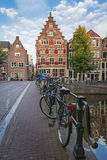 Bicycles parked on a bridge across the canal Oudezijds Voorburgw Royalty Free Stock Images