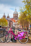 Bicycles parked at the bridge in Amsterdam Royalty Free Stock Photography