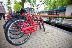 Bicycles parked by the canal in Amsterdam Stock Photography