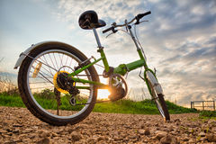Bicycles parked on a dirt road during sunset Royalty Free Stock Image