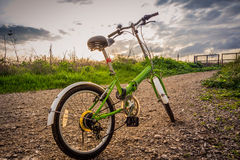 Bicycles parked on a dirt road during sunset Royalty Free Stock Images