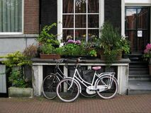 Bicycles parked in front of canal house Royalty Free Stock Photography