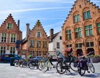 Bicycles are parked in front of historical buildings Stock Photography