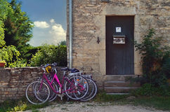 Bicycles parked in front of a rustic house Stock Images
