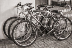 Bicycles parked in front of a rustic house Royalty Free Stock Images