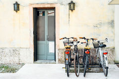 Bicycles. Parked in front of the wall Royalty Free Stock Images
