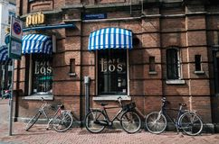 Bicycles parked near cafe in center of Amsterdam, the Netherlands Stock Photos