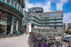 Bicycles parked near the new modern office building Stock Images