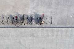 Bicycles Parked On Street. Top View Stock Photos