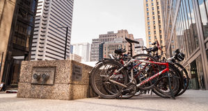 Bicycles Parked On The Street In Downtown Toronto Royalty Free Stock Image