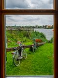 Bicycles parked outside Traditional Dutch house in Zaanse Schans. The Zaanse Schans is a typically Dutch small village in Amsterda
