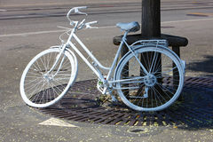 Bicycles parked roadside Stock Photo