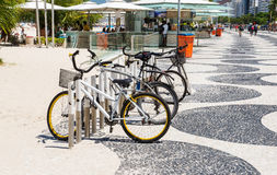 Bicycles parked on sidewalk of Copacabana in Rio de Janeiro Royalty Free Stock Images