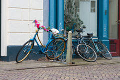 Bicycles parked in the street Royalty Free Stock Images