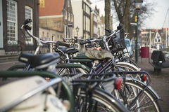 Bicycles parked in a street Royalty Free Stock Images
