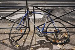 Bicycles parked in the street. Old bicycle parked in the street royalty free stock photo