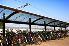 Bicycles Parked at Train Station Stock Image