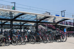 Bicycles parked at a train station Royalty Free Stock Photography