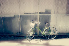 Bicycles parked by the wall  - vintage and soft style Royalty Free Stock Photo