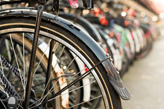 Bicycles parking on bicycle rack in downtown Amsterdam, The Neth Royalty Free Stock Photography