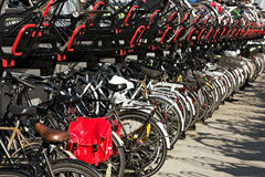 Bicycles parking on bicycle rack in downtown Amsterdam, The Neth Stock Photos
