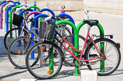 Bicycles at the parking lot Royalty Free Stock Photos