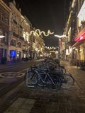 Bicycles on parking on narrow old street in European city stock photo