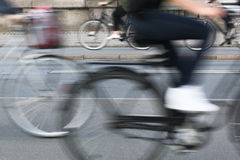 Bicycles pasing by in Copenhagen. Blurred motion. Royalty Free Stock Photo