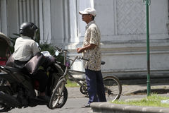 Bicycles. People using bicycles as transportation in the city of Solo, Central Java, Indonesia Stock Photo