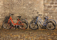 The bicycles. Photo image of road  with  wall and bicycles Royalty Free Stock Photos