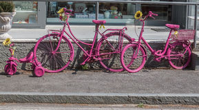 Bicycles pink. Bicycles leaning against the wall above the sidewalk Royalty Free Stock Photo