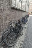 Bicycles placed against the wall in the street stock photos