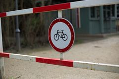 Bicycles prohibited. German metal sign on a barrier which means bicycles forbidden Royalty Free Stock Photos